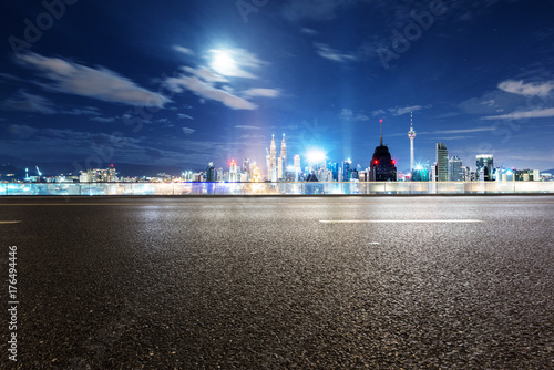 empty asphalt road with cityscape of modern city Poster