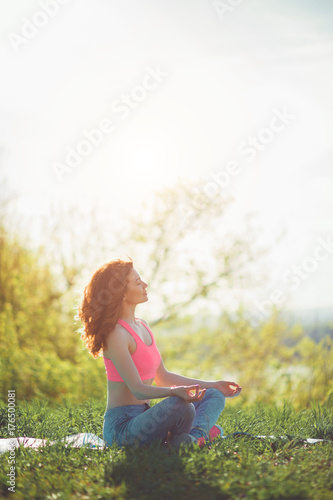Plakat yoga girl in the summer park pose meditation