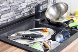 Dirty kitchenware in the sink. - 176500285