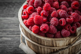 Raspberries in bucket on vintage wooden board close up view - 176508442