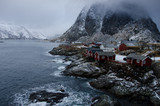 Small village on the coast of the Lofoten Islands in Norway in the morning, in the background snowy mountains