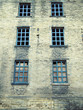 abandoned disused old derelict factory or mill building with blue broken windows in halifax west yorkshire england