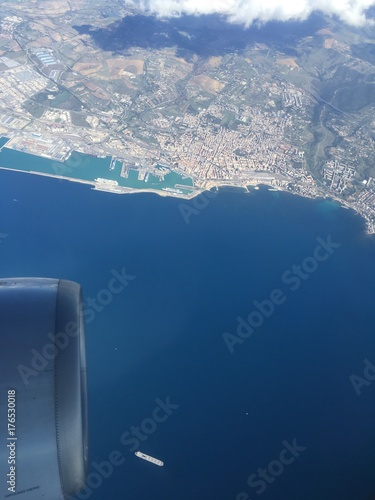 flying over the sea close to Rome airport