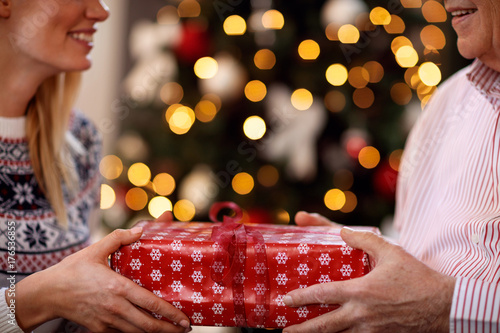 father and daughter exchanging Christmas gifts.