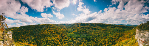 Aluminium Bleke violet panoramic autumn landscape. view of the yellow forest and blue cloudy sky on a warm Sunny autumn day