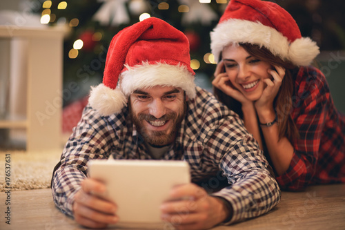 Christmas couple buying on net for holiday