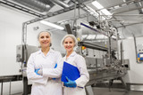 happy women technologists at ice cream factory - 176543859