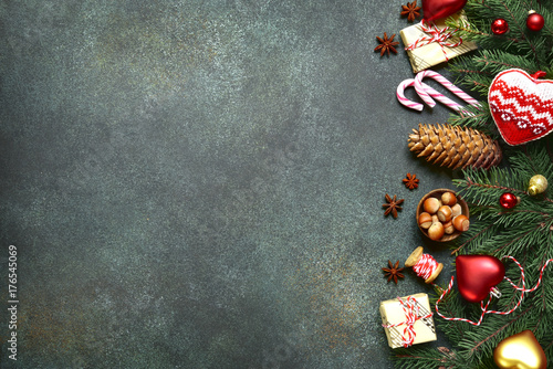 Dark christmas background with fir branchs,toys and gift boxes .Top view with copy space. - 176545069