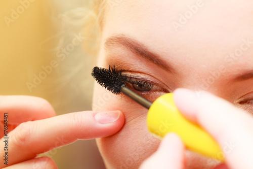 Close up woman getting make up, mascara Poster