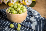 Fresh gooseberry in a wooden bowl. - 176552438