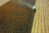 Aerial view of yellow harvester on corn field - 176557003