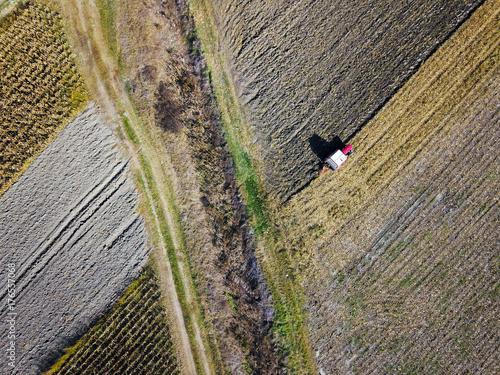 Fotobehang Trekker Aerial view of Tractor harrowing soil