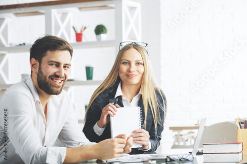 Fridge magnet Attractive businesspeople working on project