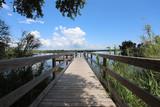 wood dock walkway in waterway