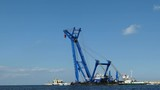 Floating Crane Vessel On A River And Sea - 176571431