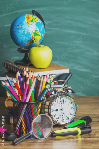 School supplies on the background of the school board - 176572867