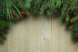 Christmas tree branches on wooden background - 176583431