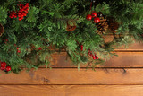 Christmas tree branches on wooden background - 176583444