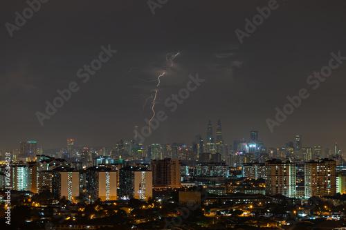 Lightning during thunderstorm over downtown Kuala Lumpur, Malaysia Poster