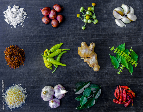 Keuken foto achterwand Boodschappen Top view of food ingredients and condiment on the table, Ingredients and seasoning on dark wooden floor, Thai spicy ingredients with chili, garlic, sugar, salt, herb
