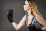 Boxer girl exercise with boxing gloves. - 176588802