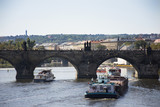 Barge and Tugboat cargo ship and River Cruises sailing in Vltava river near Charles Bridge - 176591297