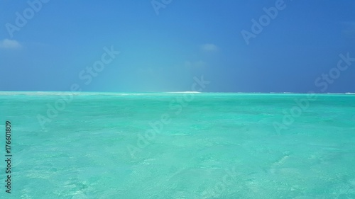 Foto op Canvas Groene koraal P02856 Maldives beautiful white sandy beach background on sunny tropical paradise island with aqua blue sky sea water ocean 4k
