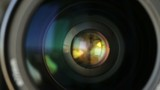 Rotate the camera lens horizontally. Closeup. - 176603693
