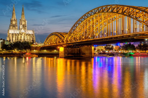 Wall mural Cologne Cathedral and Hohenzollern Bridge at night, Germany