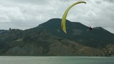 the paraglider flies over the sea bay - 176621229