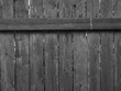 black and white battered wood fence