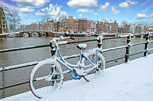 Bicycle in Amsterdam the Netherlands covered in snow