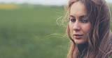 Portrait of Woman Standing on the Wind. SLOW MOTION 4K DCi. Breeze is playing with girls hair. Stormy weather, autumn, winter, spring.  - 176624066