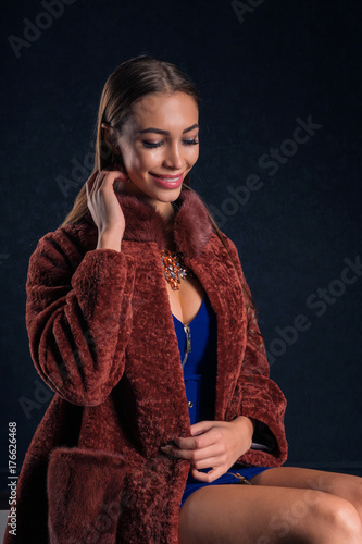 Plakát Beautiful luxury winter woman. In a brown fur coat mink.