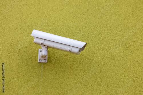 Kamera zur Überwachung an der Wand Poster