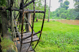 The old steel water turbine,Thai style in a forest - 176638054