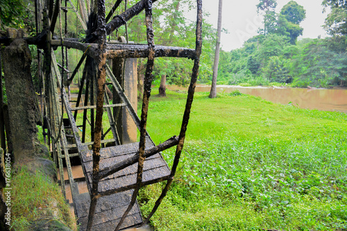 The old steel water turbine,Thai style in a forest Poster