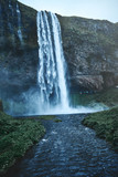 famous Seljalandsfoss waterfall in southern Iceland. treking in Iceland. Travel and landscape photography concept