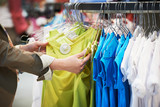 shopping. Woman hands choosing clothing - 176644660