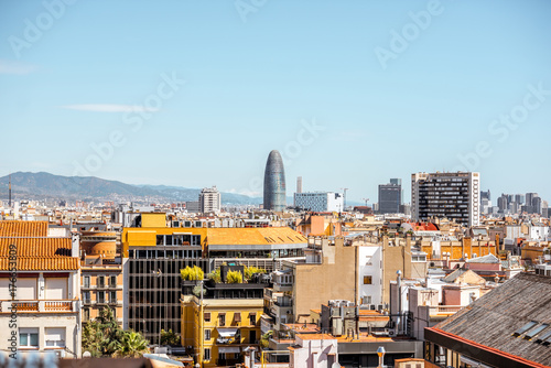 Fotobehang Barcelona Skyline view with Agbar tower, residential buildings and mountains on the background in Barcelona city