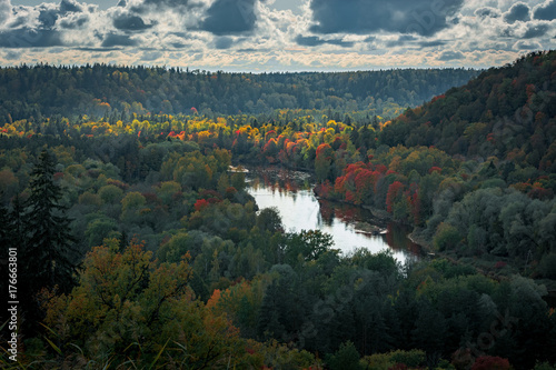 Papiers peints Bleu vert Picturesque view on valley of Gaujas national park. Trees changing colors in foothills. Colorful Autumn day at city Sigulda in Latvia.