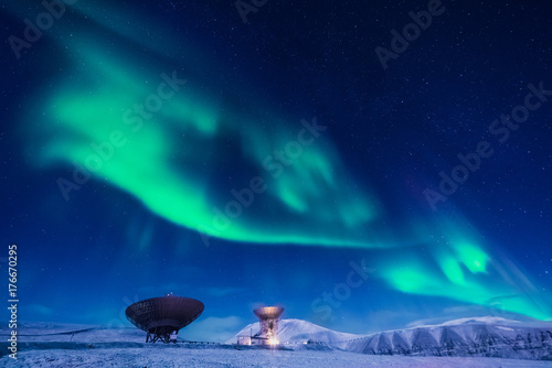 Foto op Canvas UFO The polar arctic Northern lights aurora borealis sky star in Norway Svalbard in Longyearbyen the moon mountains