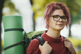 Portrait of a girl teenager tourist with backpack outdoor - 176679041