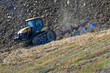 Tractor plowing a hilly field