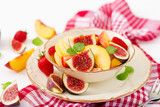 Vegan salad with figs, peaches, pears and strawberries