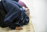 Muslim people are praying - 176686083