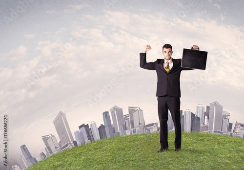 man standing in front of city landscape