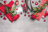 Female Valentines day or Dating accessories in red color: shoes, panties, roses flowers, candles, crown and blank paper card with heart on gray background, top view, border - 176688609