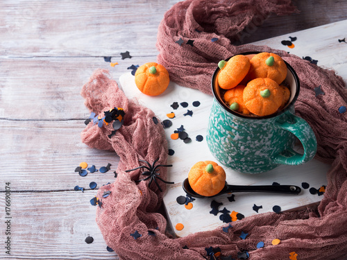 Foto op Canvas Chocolade Mug of hot chocolate with Pumpkin shaped halloween marshmallows with holiday decorations. Children party