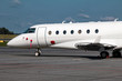 White private business plane at the parking lot of airport